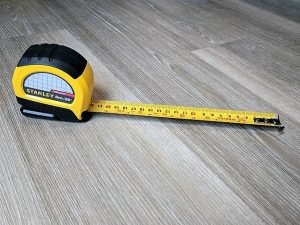 tape measure indicating six foot distance between people