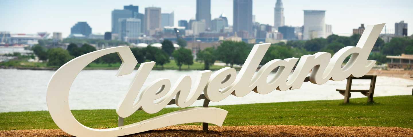 Cleveland sign with skyline in background
