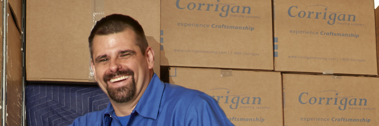 mover standing in front of wall of boxes loaded on truck